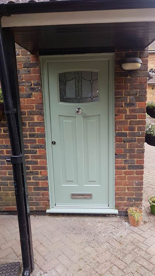 Installed front door, green.